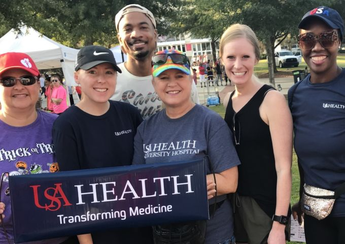 USA Health employees helped raise funds to fight heart disease and stroke at the 2019 Mobile Heart Walk.
